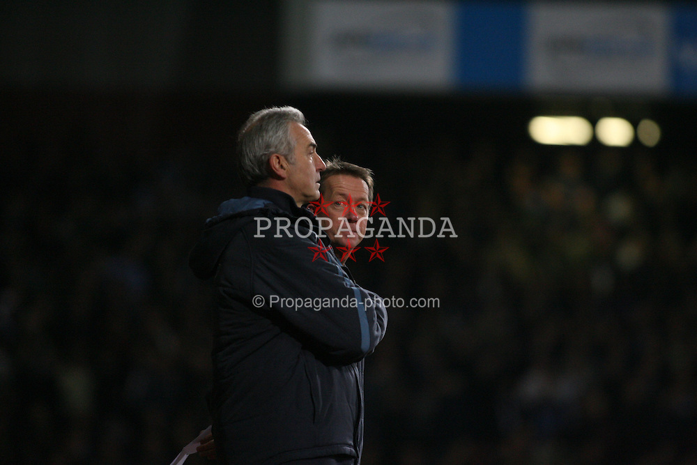 London, England - Tuesday, January 30, 2007: Liverpool against West Ham United's manager Alan Curbishley as he looks at Mervyn Day his assistant during the Premiership match at Upton Park. (Pic by Chris Ratcliffe/Propaganda)