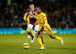 Raheem Sterling of Liverpool is challenged by Dean Marney of Burnley - Photo mandatory by-line: Rogan Thomson/JMP - 07966 386802 - 26/12/2014 - SPORT - FOOTBALL - Burnley, England - Turf Moor Stadium - Burnley v Liverpool - Boxing Day Christmas Football - Barclays Premier League.
