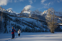 Russell Laman (age 12) and Jessica Laman (age 9)  cross-country skiing below the Teton Range, right toward the Grand Teton.<br />