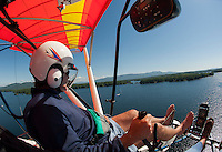 Keith Markley treats me to a birds eye view as we fly over Lake Winnipesaukee overlooking Black Cat Island in Center Harbor Bay from his two seater Quicksilver Seaplane on Friday morning.  (Karen Bobotas/for the Laconia Daily Sun)