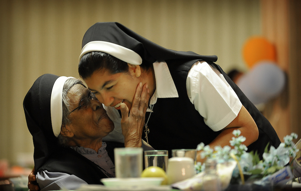 CATONSVILLE, MD -- 9/16/08 -- OBLATE SISTERS -- Sr. Mary Emily Burks (left), greets Sr. Aracelly Salazar, who was visiting from the mission in Costa Rica. Throughout their history the Oblate Sisters of Providence have expanded their missions globally wherever there are people of color. In addition to Costa Rica, they have missions in Puerto Rico, the Dominican Republic, and Nigeria.... Oblate Sisters of Providence... by André Chung #AFC_0938