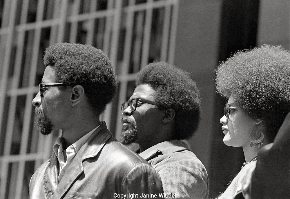 "Kathleen Cleaver with Peco (left) and Frank (center) at ""Free Huey Newton rally"" at Federal Building in San Francisco, California on Mayday 1969"