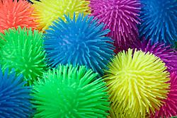 Closeup of spiky coloured rubber balls,