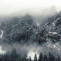 Dark mountain rocks at winter time