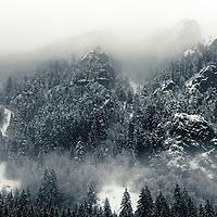 Dark mountain rocks at winter time