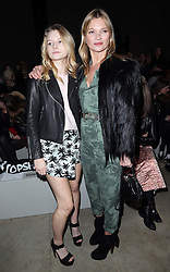 Kate Moss with her sister Lottie at the Topshop Unique show at London Fashion Week A/W 14, Sunday 16th February 2014. Picture by Stephen Lock / i-Images