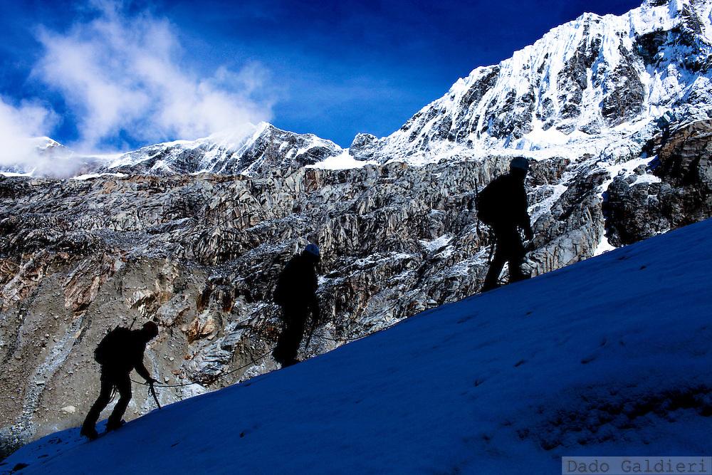 Peruvian mountain guides Juan Morales, Abel Colana and Carlos Callupe trek the White Mountain range  near Huaraz, Peru, Saturday, Jan. 15, 2011.(Photo Dado Galdieri)