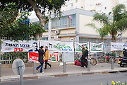 Israel, Tel Aviv, General Election Day on February 10th 2009 Signs, banners and posters outside a voting complex whith potential voters on their way to vote