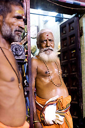 Two gentlemen outside of a temple in Southern India.