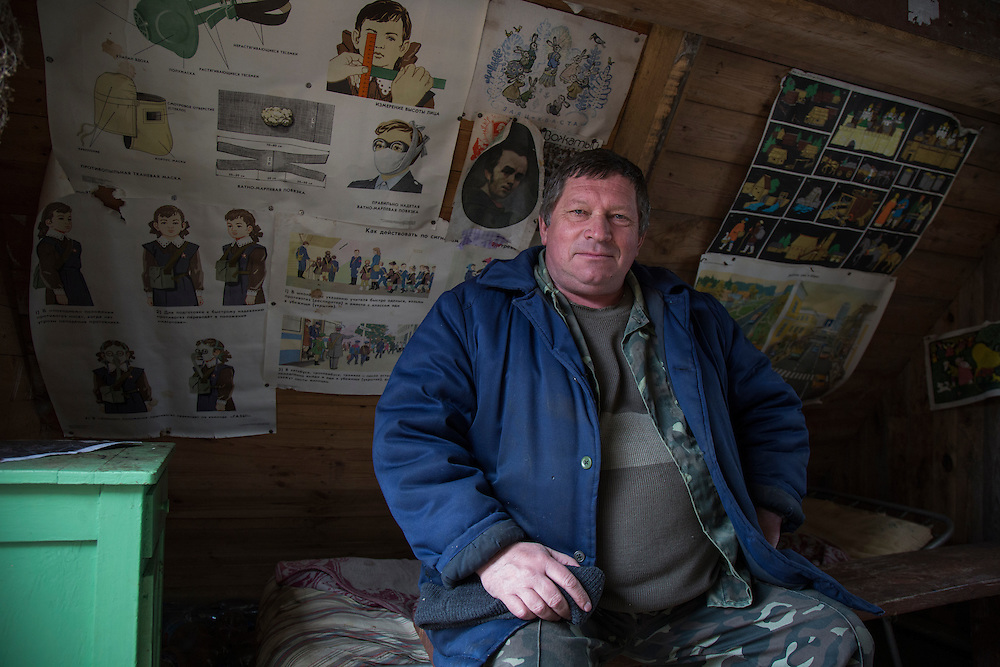 Oleksandr Maloshenko, a fire lookout in the Chernobyl Exclusion Zone sits in his hut, which he has decorated with fallout preparedness posters he scavenged from a nearby abandoned school. The nuclear catastrophe in Ukraine in 1986 forced out thousands of residents from the region. Slowly, the abandoned countryside, city of Pripyat and villages have been repopulated with wild animals, including endangered species.
