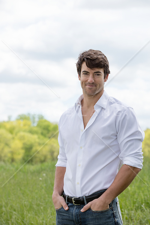 confident man outdoors in a button down shirt