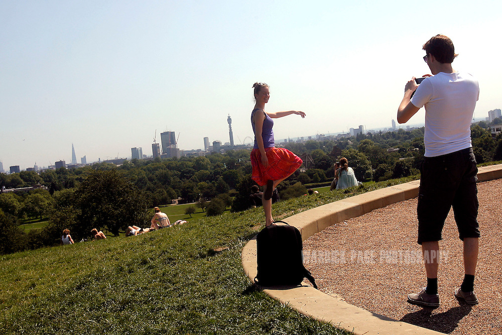 Visitors relax on Primrose Hill, on July 26, 2012 in London, England. The South of England continues to enjoy fine weather as the Olympic Games begin this weekend. (Photo by Warrick Page)