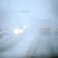 Low visibility plagues drivers on Aztec Avenue in downtown Gallup Monday.