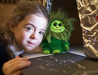 "21/01/2016  Chloe Connolly from Carnmore NS  getting ""Fuzzy"" X- rayed at the 11th Annual Teddy Bear Hospital in NUI, Galway where Med students get used to dealing with kids and Kids get used to a hospital setting with their sick teddy bears.Photo:Andrew Downes"