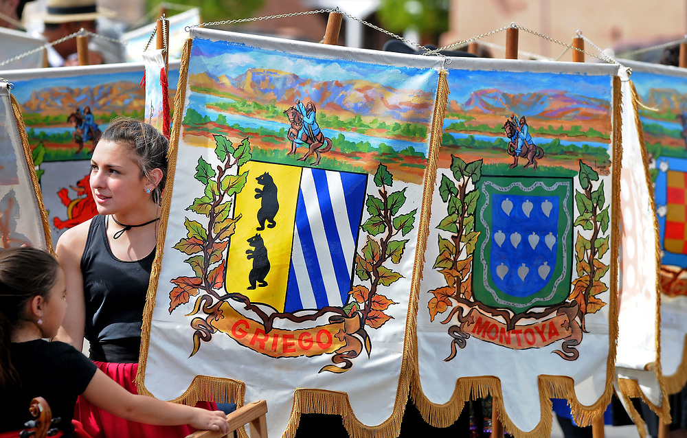 jt040817b/a sec/jim thompson/  Kayla Manzer holds the banner with one of the original family of Albuquerque at the start of the Founders' Procession during the Fiesta de Albuquerque. Saturday April 08, 2017. (Jim Thompson/Albuquerque Journal)