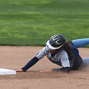 Saint Peter's College Infielder Amber Velasquez (14) slides into second base in the first inning of a NCAA Non Conference Regular season game between The University Of Delaware and The Peacocks of Saint Peter's Wednesday, April 23, 2014, at UD Softball Stadium in Newark Delaware.
