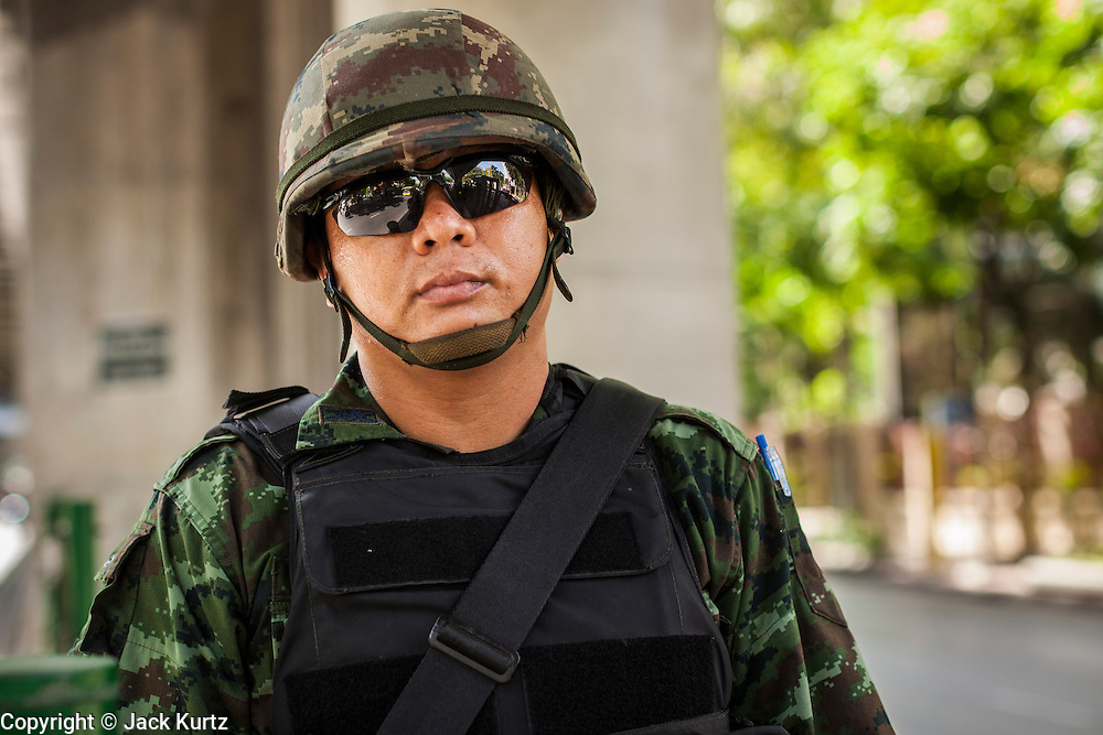 "20 MAY 2104 - BANGKOK, THAILAND:   A Thai soldier on Rama I Rd after the army declared martial law. The Thai Army declared martial law throughout Thailand in response to growing political tensions between anti-government protests led by Suthep Thaugsuban and pro-government protests led by the ""Red Shirts"" who support ousted Prime Minister Yingluck Shinawatra. Despite the declaration of martial law, daily life went on in Bangkok in a normal fashion. There were small isolated protests against martial law, which some Thais called a coup, but there was no violence.  PHOTO BY JACK KURTZ"