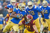 17 October 2012: Tailback (23) Jonathan Franklin of the UCLA Bruins runs the ball against the USC Trojans during the second half of UCLA's 38-28 victory over USC at the Rose Bowl in Pasadena, CA.