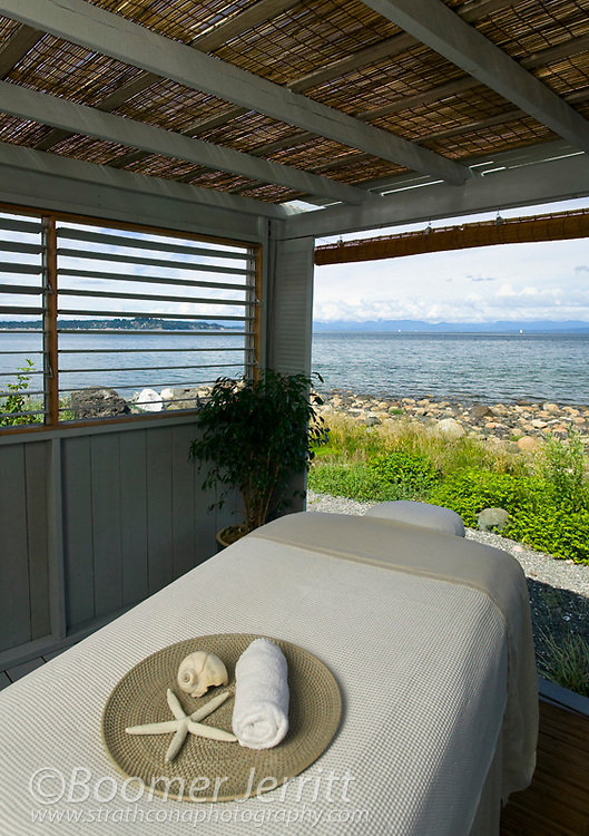 A beachside massage hut invites the pampered client to a full and invigorating massage with the heightened sense and sound of the ocean to round off the spa experience.  Courtenay, The Comox Valley, Vancouver Island, British Columbia, Canada.