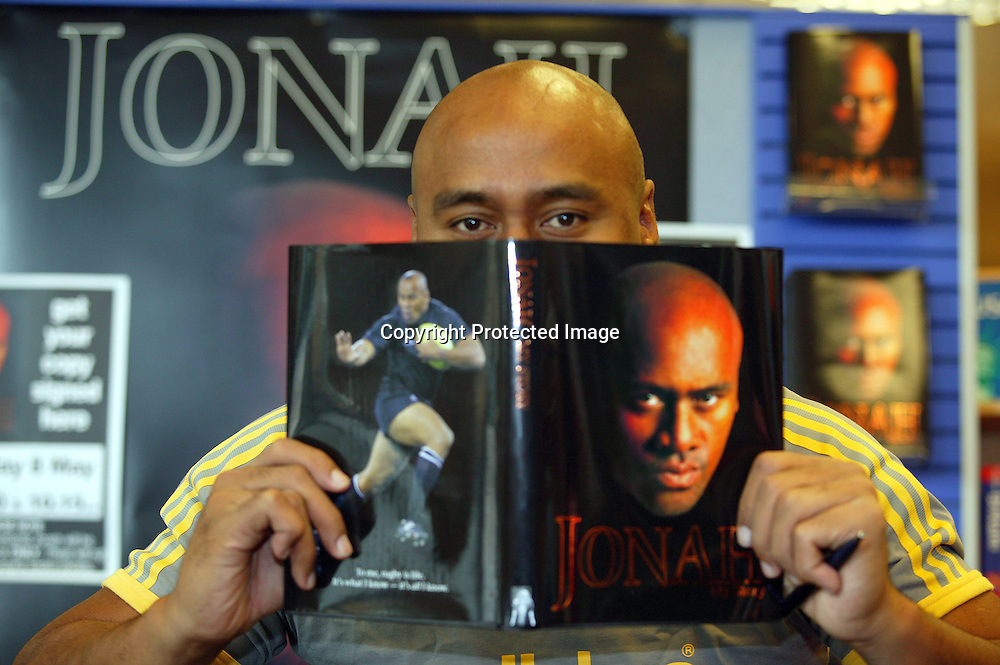 Jonah Lomu at a book signing of his autobiography &quot;Jonah My Story&quot;, Auckland, New Zealand.<br /> Picture by Barry Bland / Photosport  8/5/04