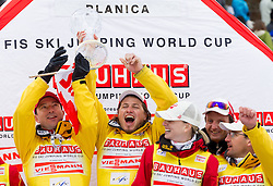 Austria, Best World Cup overall team in the season 2011/2012 with their head coach Alexander Pointner (L) celebrate at trophy ceremony after the Flying Hill Individual competition at 4th day of FIS Ski Jumping World Cup Finals Planica 2012, on March 18, 2012, Planica, Slovenia. (Photo by Vid Ponikvar / Sportida.com)