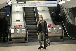 © Licensed to London News Pictures. 17/03/2020. London, UK.  A commuter wearing face mask at Kings Cross underground station. London Transport will reduce weekday services during the coronavirus crisis to a weekend level of service. Photo credit: Dinendra Haria/LNP