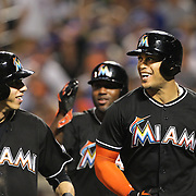 NEW YORK, NEW YORK - July 05: Giancarlo Stanton #27 of the Miami Marlins celebrates his three run homer with Christian Yelich #21 of the Miami Marlins in the eighth inning during the Miami Marlins Vs New York Mets regular season MLB game at Citi Field on July 05, 2016 in New York City. (Photo by Tim Clayton/Corbis via Getty Images)