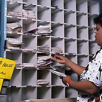 A U.S. Postal Service worker manually sorts mail in the Brentwood, Maryland U.S. Postal Service facility destined for delivery to the White House in 1989.