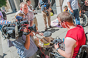 DPAC organise a protest outside the Department of Work and Pensions to demand that they save the Independent Living Fund. There is a heavy police presence in the background, after the Abbey closure at the weekend, but the liaison officers are very friendly. The BBC send a film crew, including a blind reporter, after ignoring previous protests. Westminster, London, UK 04 July 2014.