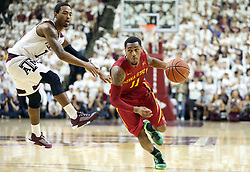 Iowa State's Monte Morris (11) dribbles by Texas A&M's Anthony Collins (11) during the second half of an NCAA college basketball game, Saturday, Jan. 30, 2016, in College Station, Texas. Texas A&M won 72-62. (AP Photo/Sam Craft)