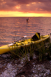 Stock photo of a man flyfishing with his kayak on shore along the Texas Gulf coast.