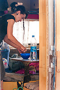 Lady preparing food in a mobile home at Middle East Tek, Wadi Rum, Jordan, 2008 Middle East Tek, Wadi Rum, Jordan, 2008