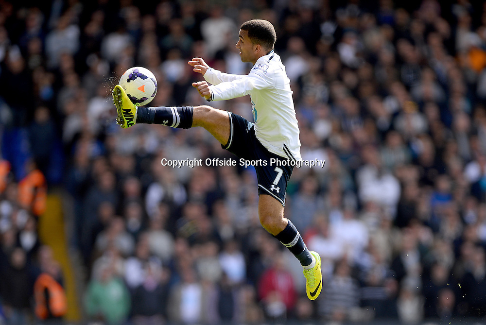 19 April 2014 - Barclays Premier League - Tottenham Hotspur v Fulham - Aaron Lennon of Tottenham Hotspur leaps to control the ball - Photo: Marc Atkins / Offside.