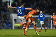 Portsmouth Midfielder, Gareth Evans (26) and Shrewsbury Town Midfielder, Alex Rodman (23) challenge for the ball during the EFL Sky Bet League 1 match between Portsmouth and Shrewsbury Town at Fratton Park, Portsmouth, England on 27 January 2018. Photo by Adam Rivers.