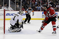 Dec 30, 2009; Newark, NJ, USA; Pittsburgh Penguins goalie Brent Johnson (1) makes a pad save on New Jersey Devils center Travis Zajac (19) during the second period at the Prudential Center.