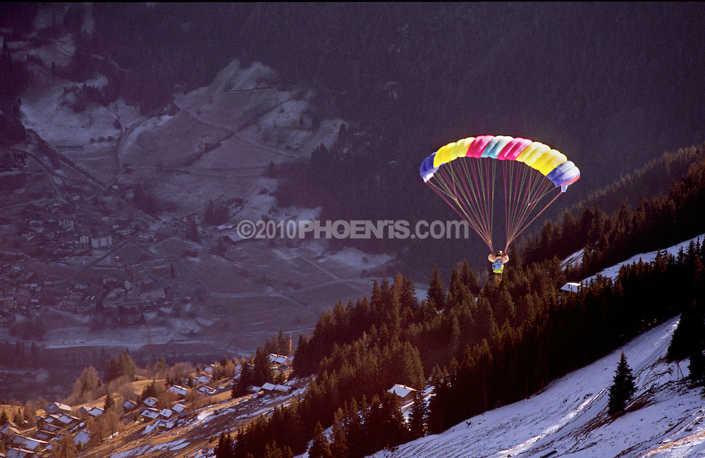 Parascending (Parapente) over Verbier Switzerland. Sunrise in the Swiss Alps mountains SPORT