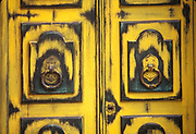 Weathered yellow doors in Buenos Aires, Argentina.