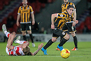 Louis Dodds (Port Vale) tackles the Doncaster Rover player and comes away with the ball during the Sky Bet League 1 match between Doncaster Rovers and Port Vale at the Keepmoat Stadium, Doncaster, England on 26 January 2016. Photo by Mark P Doherty.
