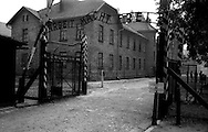 The entrance to Auschwitz, former Nazi death camp, in Oswiecim, with the inscription 'Arbeit macht frei'. The infamous sign at the entrance of Poland's Nazi-era concentration camp, Auschwitz, 'Arbeit macht frei' ('Work will set you free') . (Il lavoro rende liberiI).