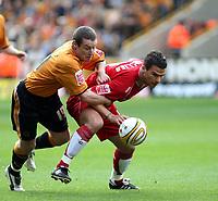 Photo: Mark Stephenson.<br /> Wolverhampton Wanderers v Norwich City. Coca Cola Championship. 22/09/2007.Norwich's Julian Brellier (R) gets the better of Wolve's Stephen Elliott