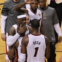 Jun 19, 2012; Miami, FL, USA; Miami Heat small forward LeBron James (6) hugs point guard Mario Chalmers (15) in front of power forward Chris Bosh (1) during the fourth quarter in game four in the 2012 NBA Finals at the American Airlines Arena. Miami won 104-98. Mandatory Credit: Derick E. Hingle-US PRESSWIRE