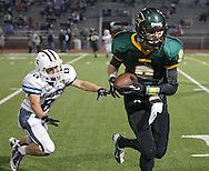 Kennedy's Patrick Martin (9) pulls in a pass for a 45 yard touchdown reception as Jefferson's Blake Bernauer (6) looks on during second quarter of the game between Cedar Rapids Jefferson and Cedar Rapids Kennedy at Kingston Stadium in Cedar Rapids on Friday September 28, 2012. It was 24-0 Kennedy at halftime.