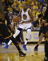 June 12, 2017 - Oakland, CA, USA - The Golden State Warriors' Kevin Durant (35) looks to pass against the Cleveland Cavaliers in the second quarter of Game 5 of the NBA Finals at Oracle Arena in Oakland, Calif., on Monday, June 12, 2017. (Credit Image: © Nhat V. Meyer/TNS via ZUMA Wire)