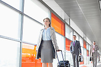 Businesspeople walking on train platform