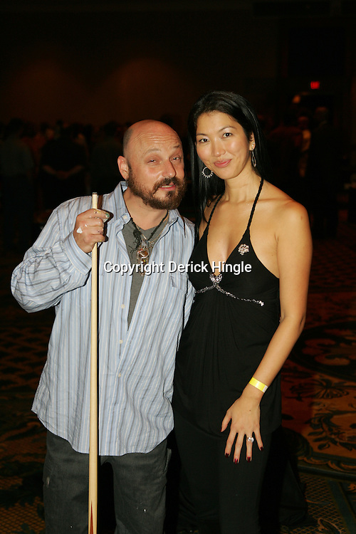 """Frenchy poses with Jennette Lee """"The Black Widow"""" of pool at the Big Easy Billiard' Bash a celebrity pool tournament and party hosted by NFL Superstar Reggie Bush and NBA Superstar (SHAQ) Shaquille O'Neal at the Hilton Riverside Hotel in New Orleans, Louisiana on February 15th 2008."""