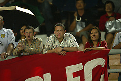 BANGKOK, THAILAND - Thailand. Thursday, July 24, 2003: A Liverpool fan with his Thai friend watch the preseason friendly match at the Rajamangala National Stadium. (Pic by David Rawcliffe/Propaganda)