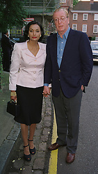 MR & MRS MICHAEL CAINE he is the actor, at a party in London on 25th June 1998.MIT 168