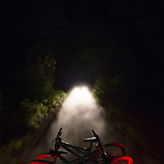 Blasting down a dirt road after dark and riding a late evening singletrack.
