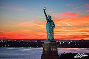 Aerial view of the Statue of Liberty at sunset, photographed from a helicopter.