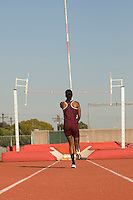 Female athlete preparing for pole jump